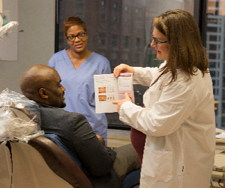 dental staff discussing treatment plan with patient
