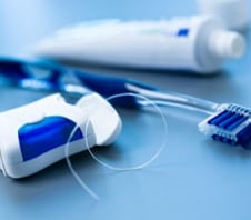 preventative dental care image of floss and toothbrush