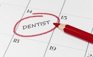 image of calendar marking dentist appointment